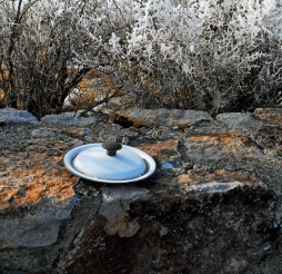 This pot lid was just sittign on the foundation wall of the camp's firestation.